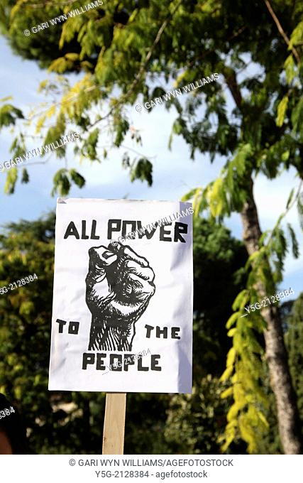 all power to the people placard at a protest in rome italy