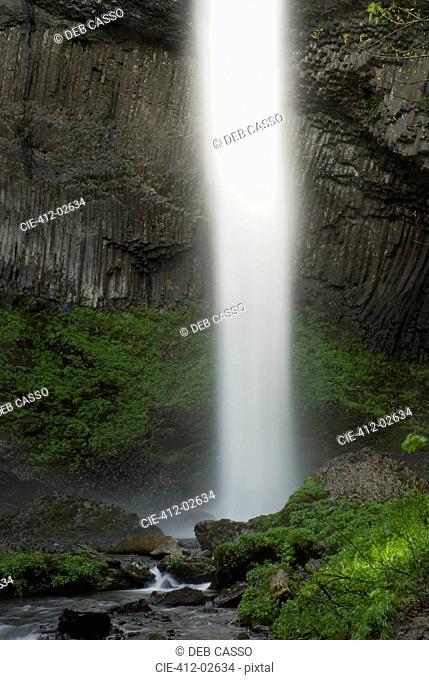 Waterfall in rocky rural landscape