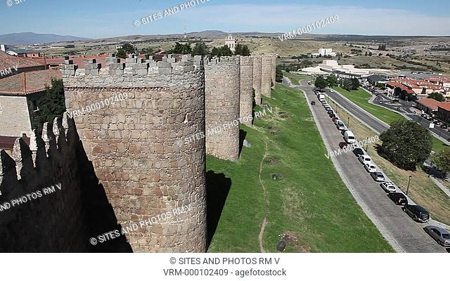 PAN, HA, Daylight. Fortified Medieval walls surrounding the World Heritage Site of Avila. Alfonso VI ordered the construction of these fortifications after his...