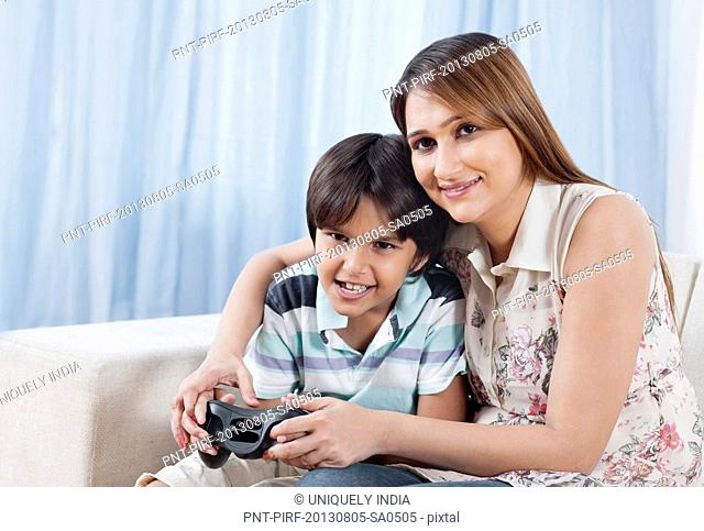 Woman playing video game with her son
