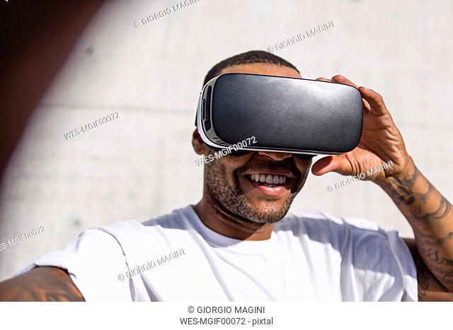 Man wearing Virtual Reality Glasses taking selfie
