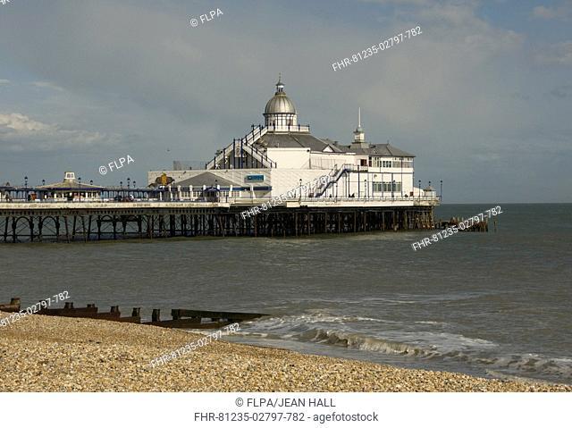 View of shingle beach, sea and pier, Eastbourne Pier, Eastbourne, East Sussex, England, april