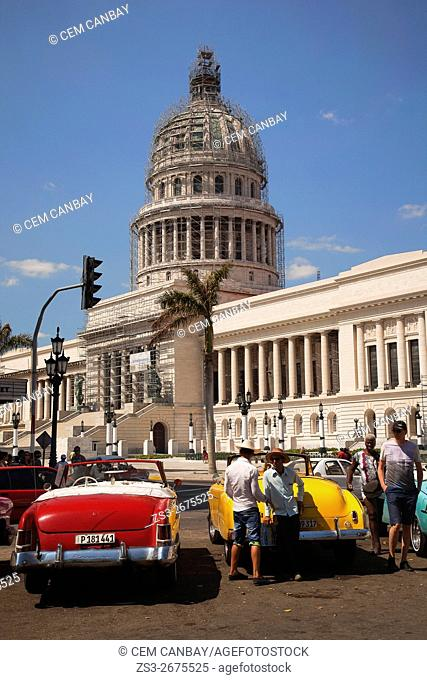Old American cars in front of the Capitolio building, Central Havana, Cuba, West Indies, Central America