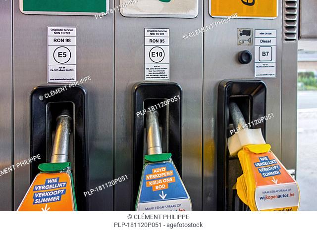 Color-coded gas pump nozzles and new EU fuel identification labels for gasoline E5 / E10 and diesel B7 at petrol station in Belgium, Europe