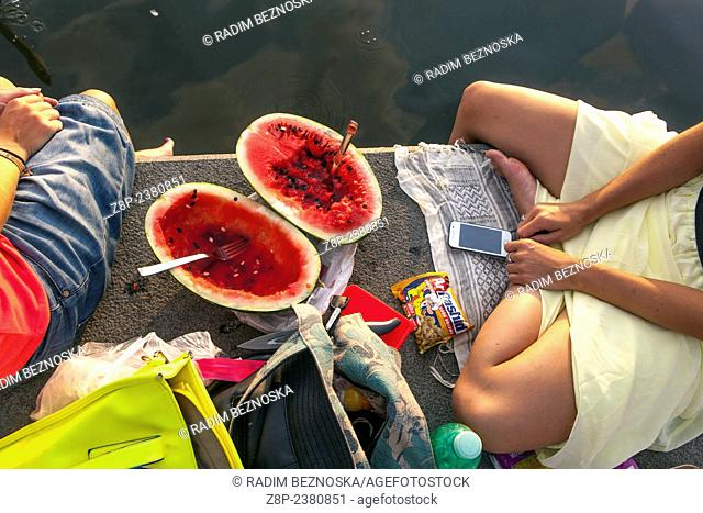 Leisure, relax and picnic on the bank of the Vltava River, Naplavka, Prague, Czech Republic, Europe