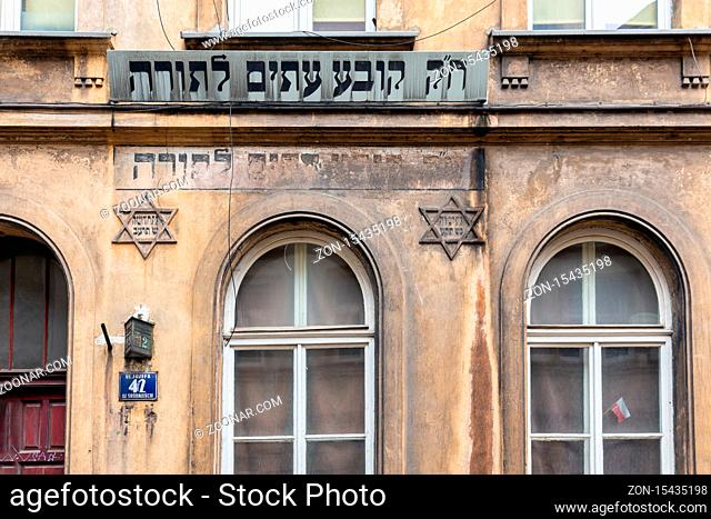 Krakow, Poland - May 16, 2019: Jewish building with Shield of David and text in Jewish Quarter Krakow