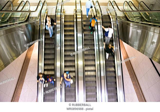 Escalators with people and motion blur