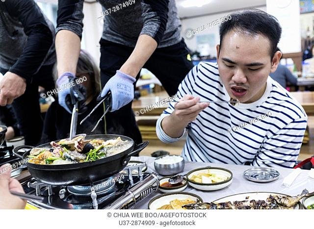 Eating seafood steamboat in Jeju Island, Korea