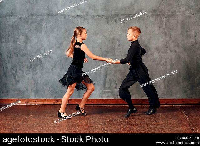 Young couple boy and girl dancing in ballroom dance Jive