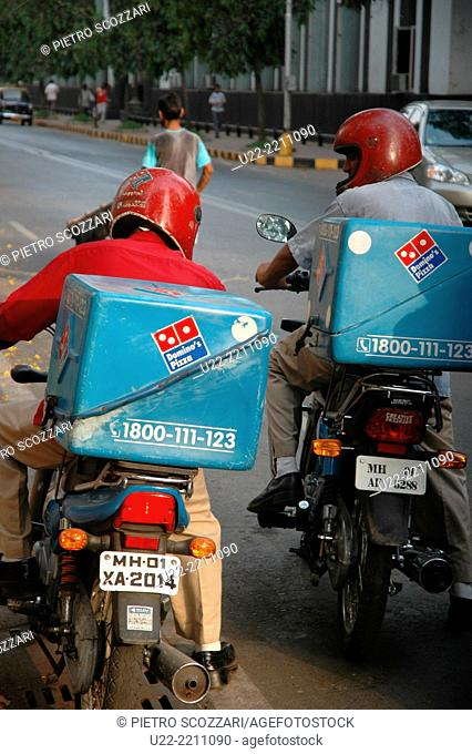 Mumbai, India: Domino's Pizza delivery guys at work