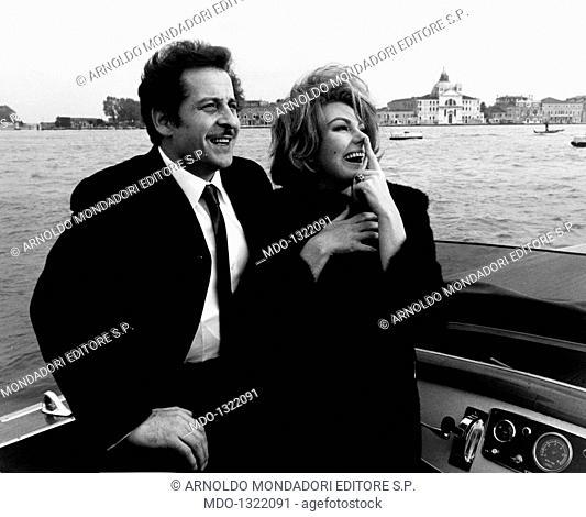 Sylva Koscina and Domenico Modugno in 'Three Bites of the Apple'. Croatian-born Italian actress Sylva Koscina and Italian singer and songwriter, guitarist