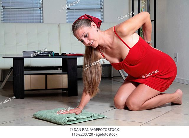 A woman mopping the floor getting hurt