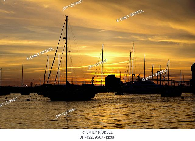 Pleasure boats anchored in Naraganset Bay off Newport, Goat Island and bridge in background; Newport, Rhode Island, United States of America