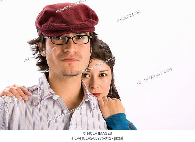 Studio portrait of young couple
