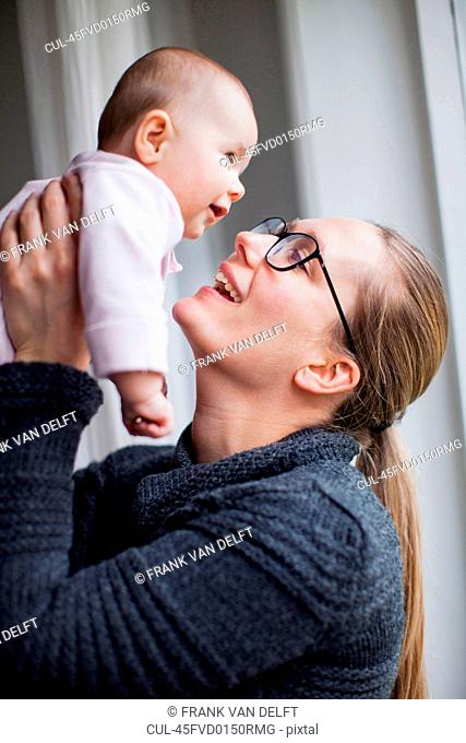 Mother holding smiling baby