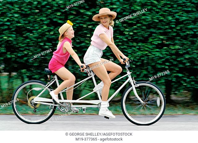 mother and daughter on a tandem bike