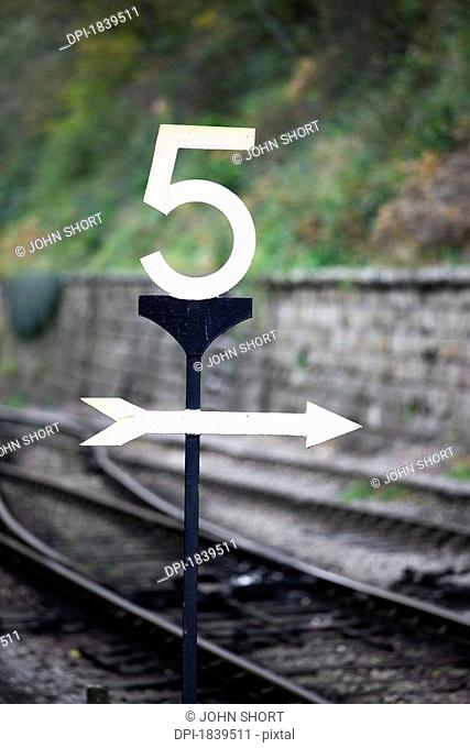Directions at a railroad crossing