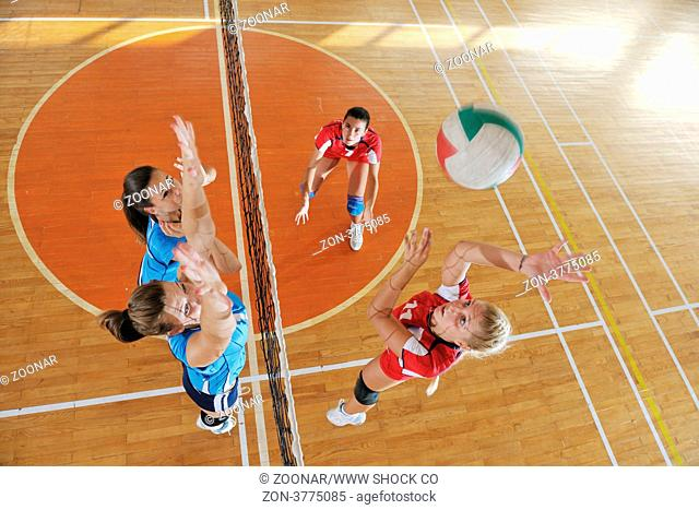 volleyball game sport with group of young beautiful girls indoor in sport arena