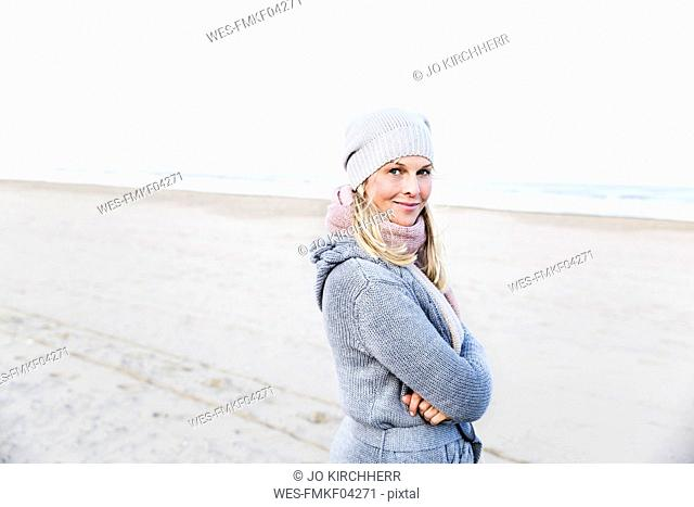 Portrait of smiling woman on the beach