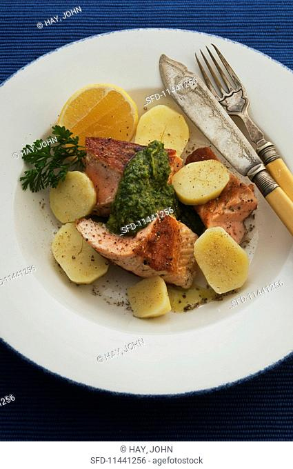 Salmon with green sauce and new potatoes