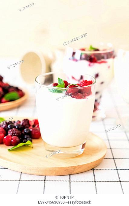 yogurt with mixed berries on the table