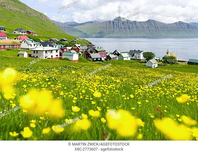 Village Oyndarfjordur, in the background the mountains of the island Kalsoy. The island Eysturoy one of the two large islands of the Faroe Islands in the North...