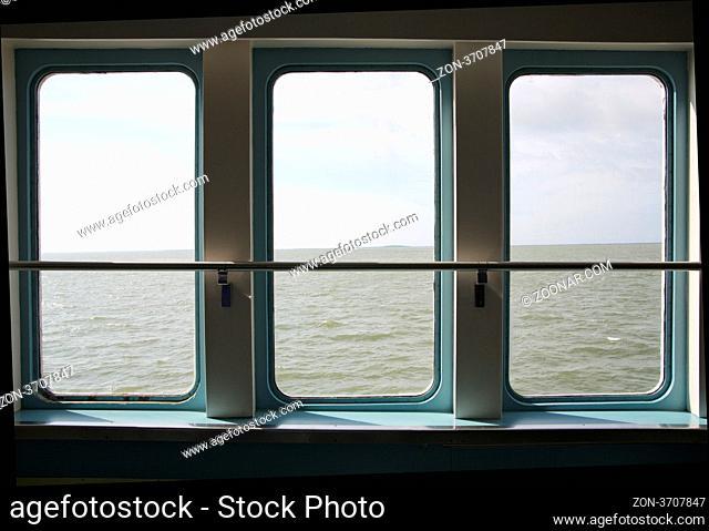 Ship porthole make wide view over smoothy sea