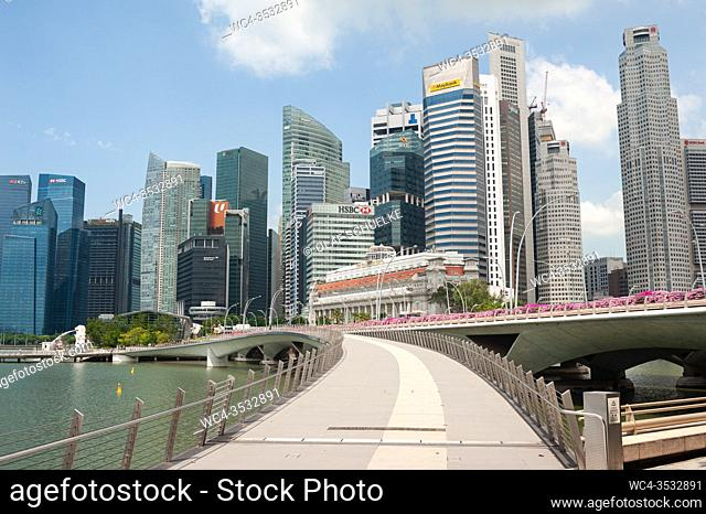 Singapore, Republic of Singapore, Asia - View across the Jubilee Bridge along the riverfront in Marina Bay of the city skyline with skyscrapers in the central...