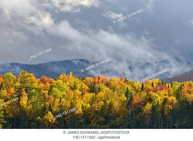 Stomy sky over fall colors over Franklin Falls Pond in the Adirondack Mountains of New York State