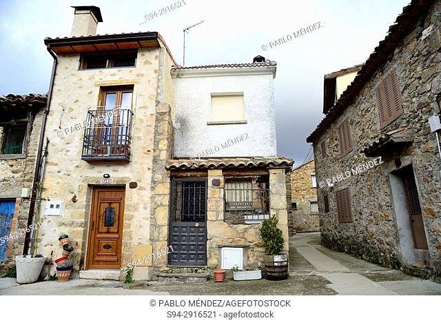Rustic facades in a small square of Madarcos, Madrid, Spain