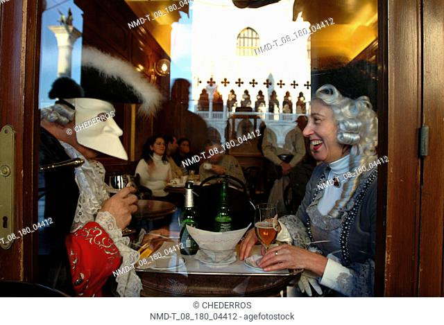 Side profile of a mature couple sitting in a restaurant, Venice, Veneto, Italy