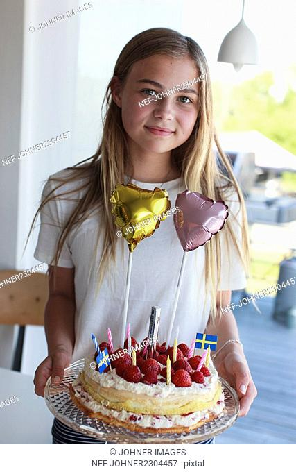 Portrait of girl with birthday cake