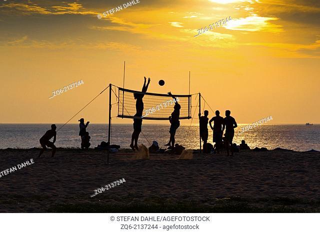Playing Volleyball on Karon Beach at Sunset, Phuket, Thailand