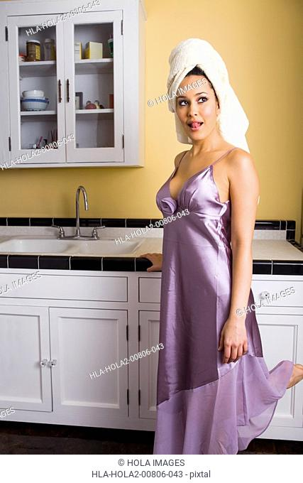 Young woman standing in kitchen