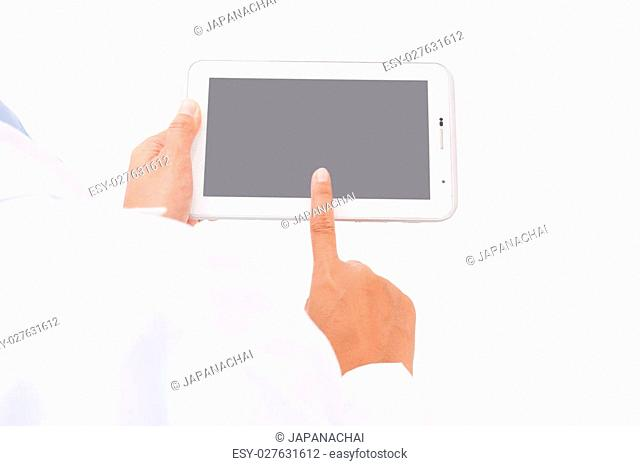 Doctor working on a digital tablet on white background