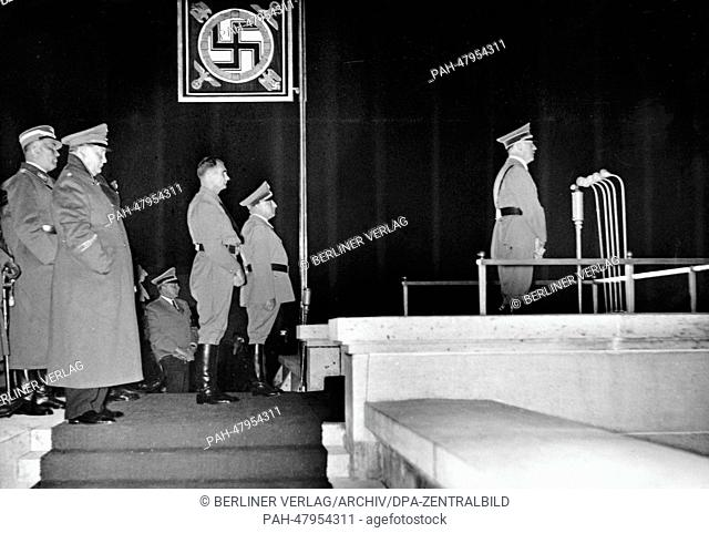 Nuremberg Rally 1937 in Nuremberg, Germany - Adolf Hitler holds a speech in an atmosphere created by searchlights in front of the political leaders of the NSDAP
