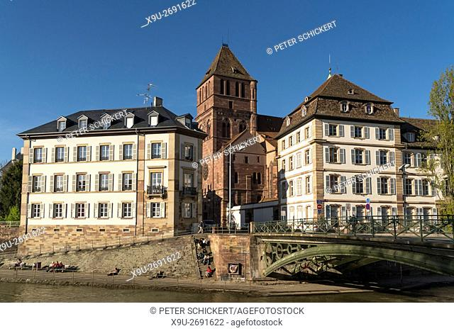 View of the River Ill with church Eglise Saint-Thomas in Strasbourg, Alsace, France