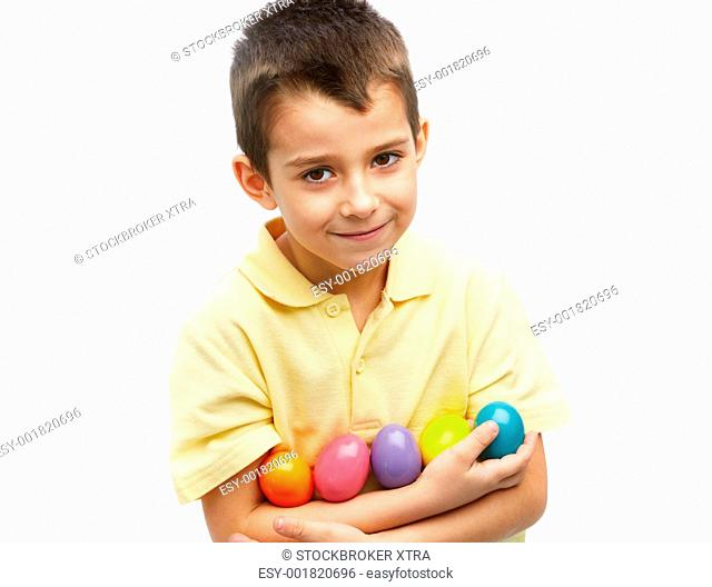 Photo of young boy with colorful Easter eggs