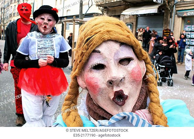Masked revelers at the annual Mardi Gras festival in Pezenas, France