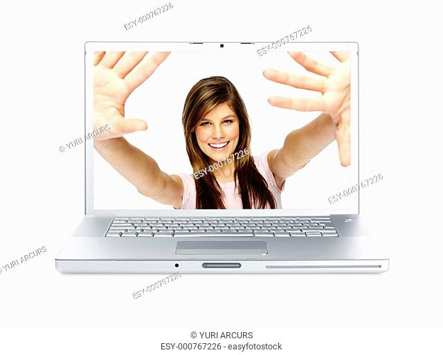 Digital composite - Portrait of a excited young woman smiling through a laptop screen