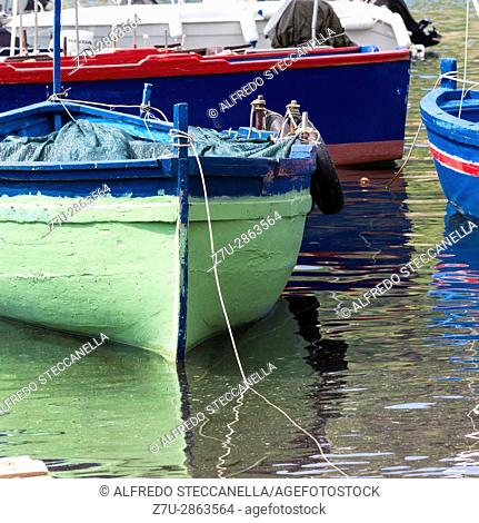 Acireale - Italy. Small traditional fishing boat, made of wood, coloured, painted, Sicily