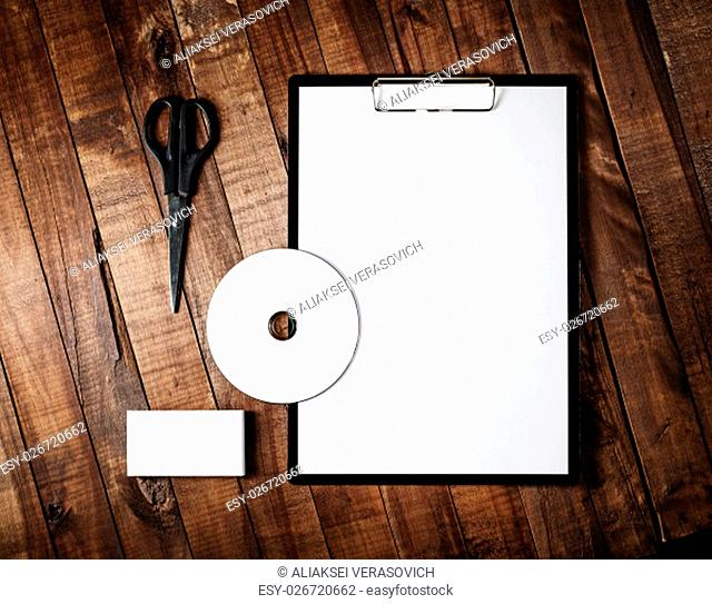 Photo of blank stationery template for branding identity for designers. Blank stationery set on vintage wooden table background