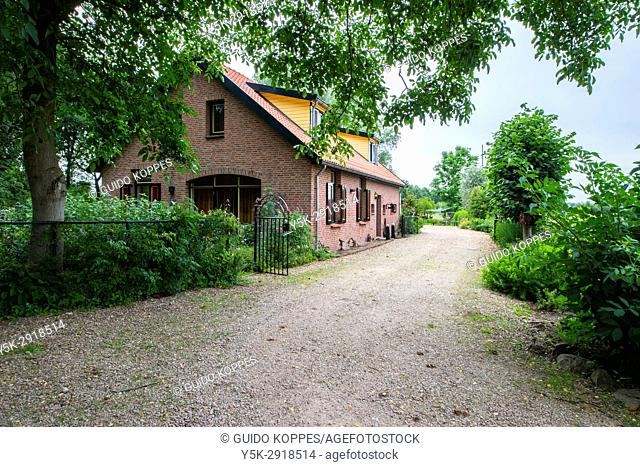 Malden, Netherlands. 20th century rural area farmers house on a dirty road