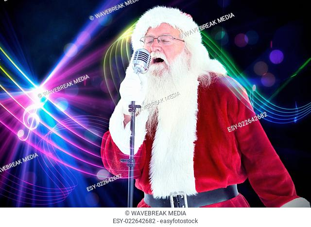 b9cec8a9e7be3 Santa claus is singing christmas songs Stock Photos and Images