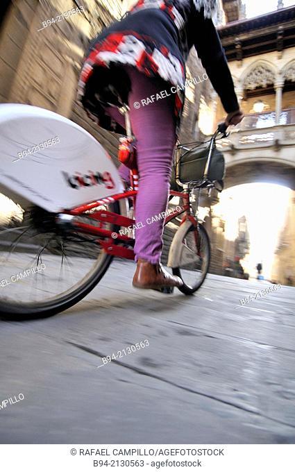 Bicycle. Bisbe street between Sant Jaume square and Nova square. Gothic area. Ciutat Vella district. Noegothic bridge, 1928
