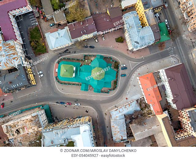 Top view of the dome of the Church of St. Nicholas Pristika, the roofs of houses and the road with parked cars, the district Podol. Kiev, Ukraine