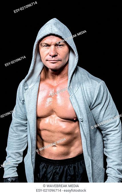 Portrait of confident macho man in hood