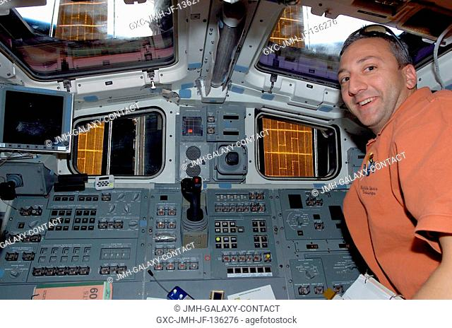 Astronaut Michael J. Massimino, STS-109 mission specialist, is pictured near the aft flight deck controls for the Space Shuttle Columbia shortly after the crew...