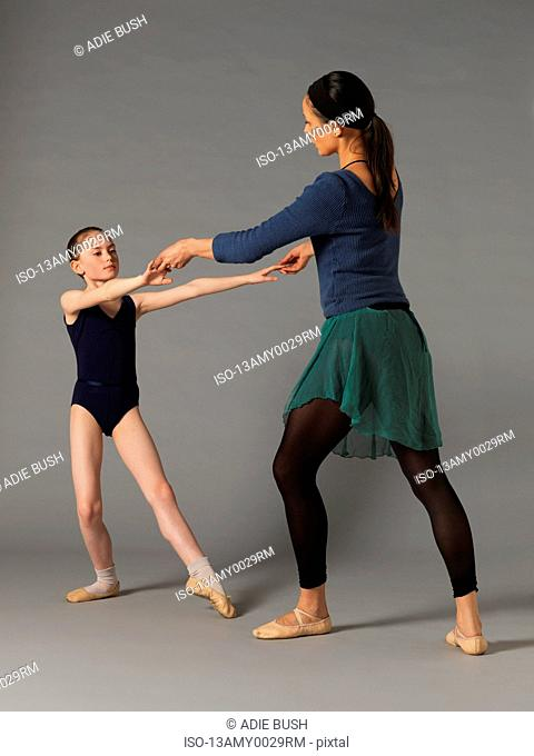 Woman and girl practicing ballet