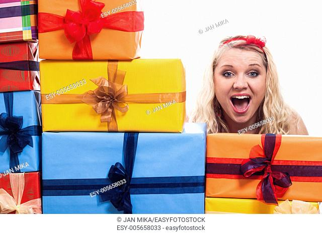 Shocked woman with many presents, isolated on white background